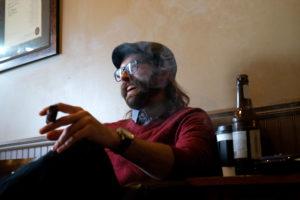 man laughing and enjoying a cigar